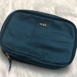 Gorgeous TUMI teal split travel kit